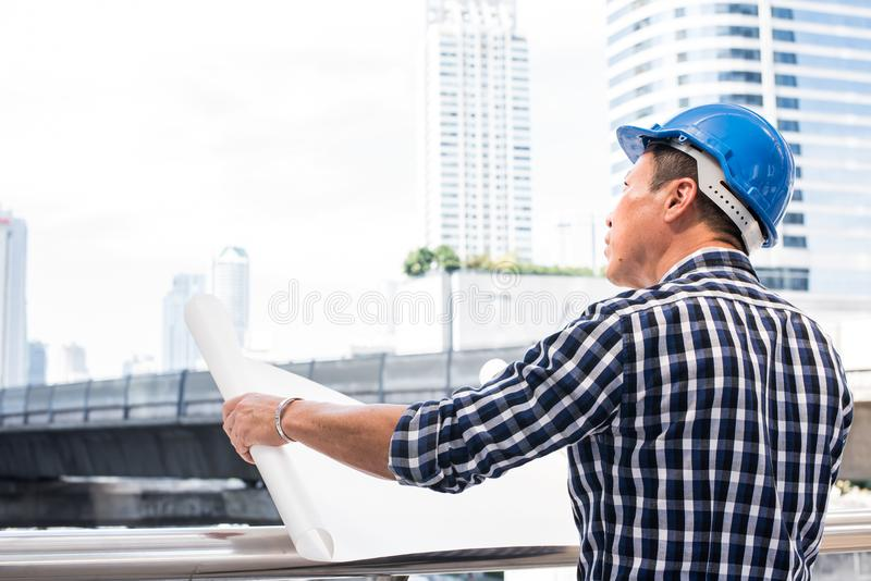 Engineering looking the blueprint royalty free stock photography