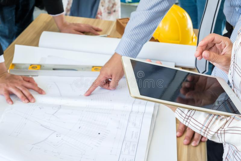 Engineering is looking tablet on a blueprint. stock photography