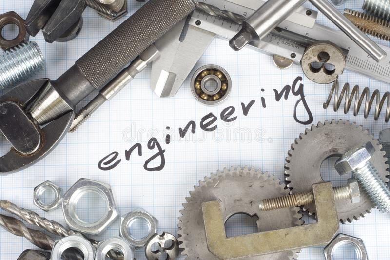 Engineering - repair parts. On graph paper background stock photos