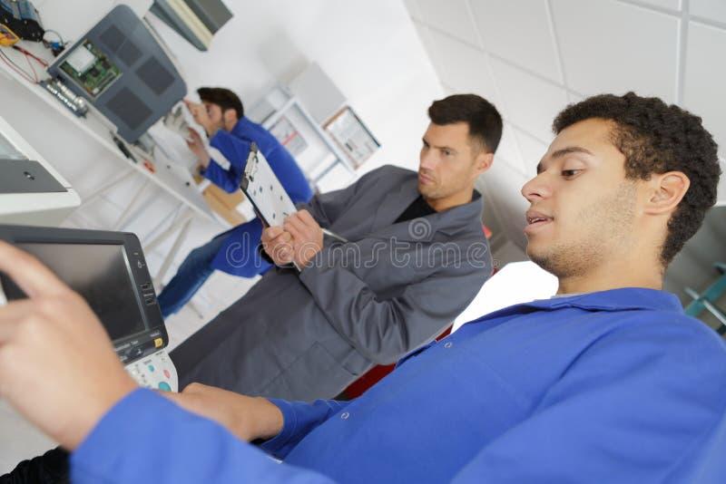 Engineering robotics class teamwork. Repairer stock images