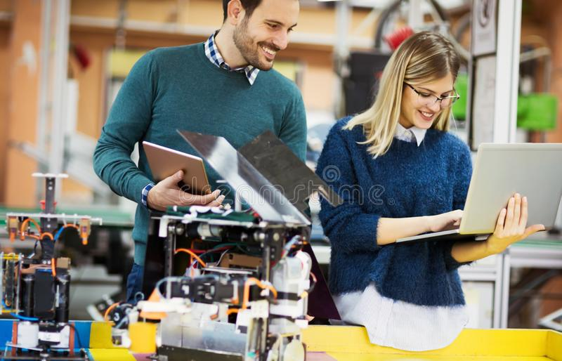 Engineering robotics class teamwork. By students royalty free stock image