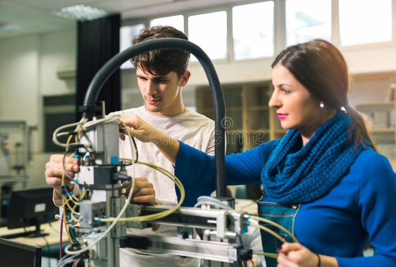 Engineering robotics class teamwork. By young students stock images