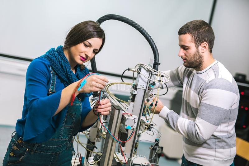 Engineering robotics class teamwork. By young students royalty free stock photography