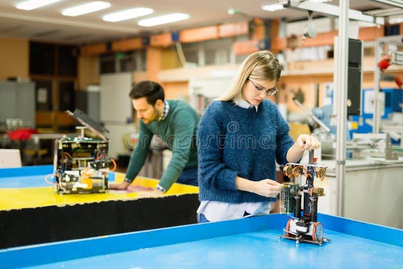 Engineering robotics class teamwork. By students royalty free stock photo