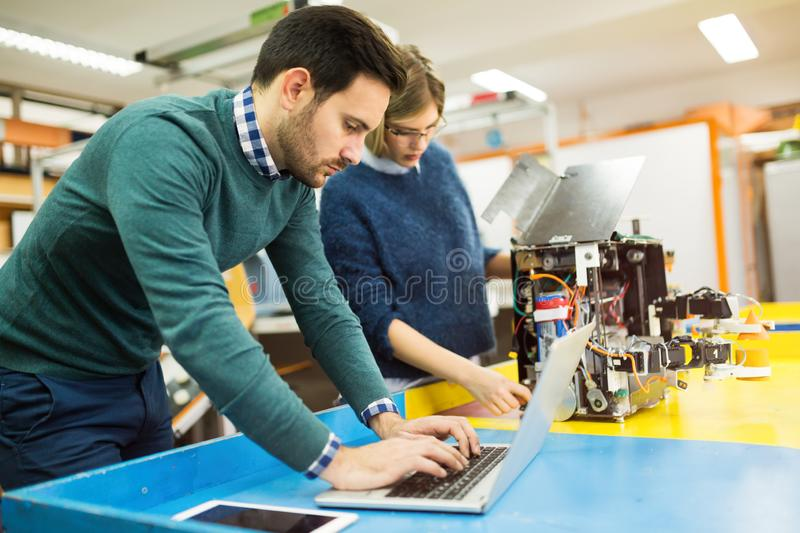 Engineering robotics class teamwork. By students royalty free stock photography