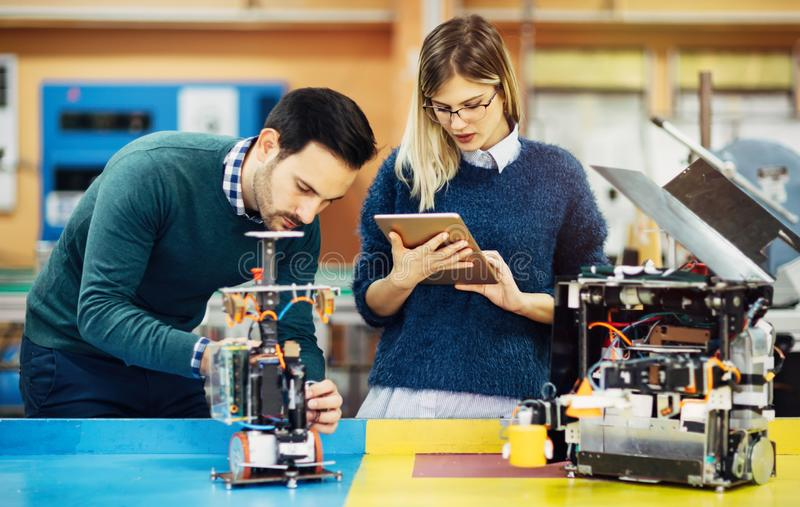 Engineering robotics class teamwork. By students stock image