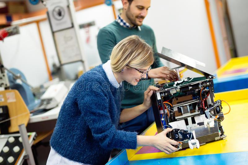 Engineering robotics class teamwork. By students stock photos