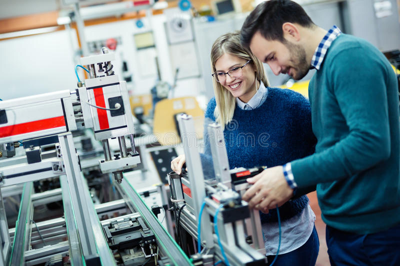 Engineering robotics class teamwork. By students royalty free stock images