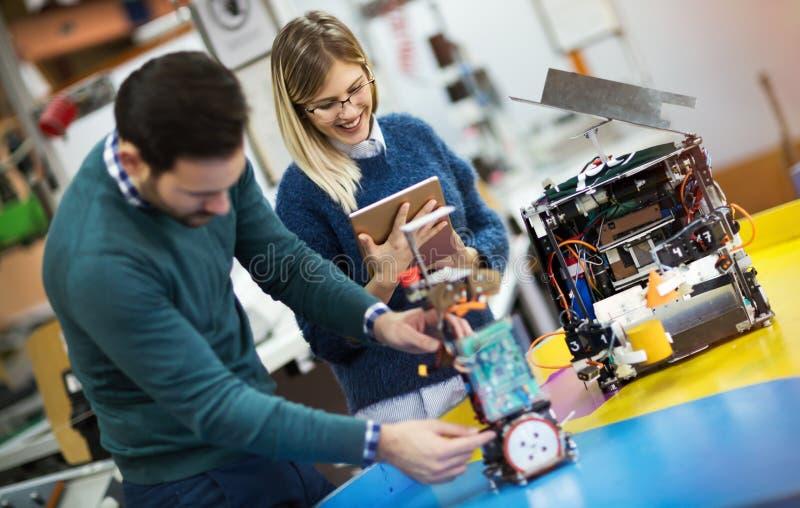 Engineering robotics class teamwork. By students royalty free stock photos