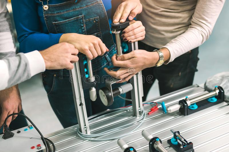 Engineering robotics class teamwork. By young students, close up royalty free stock images
