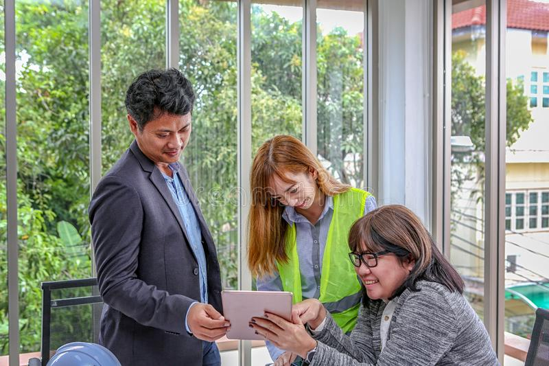 The engineering team is planning an event with joy. Group engineers discussing work in meeting room at the office. Asian people.  stock image