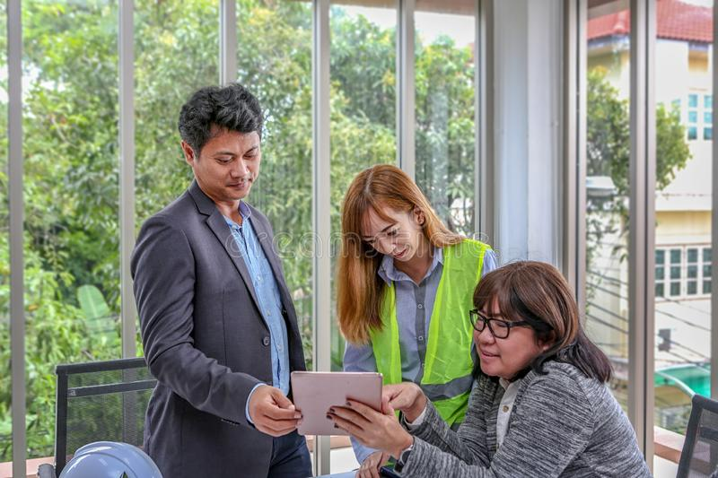 The engineering team is planning an event with joy. Group engineers discussing work in meeting room at the office. Asian people.  royalty free stock images