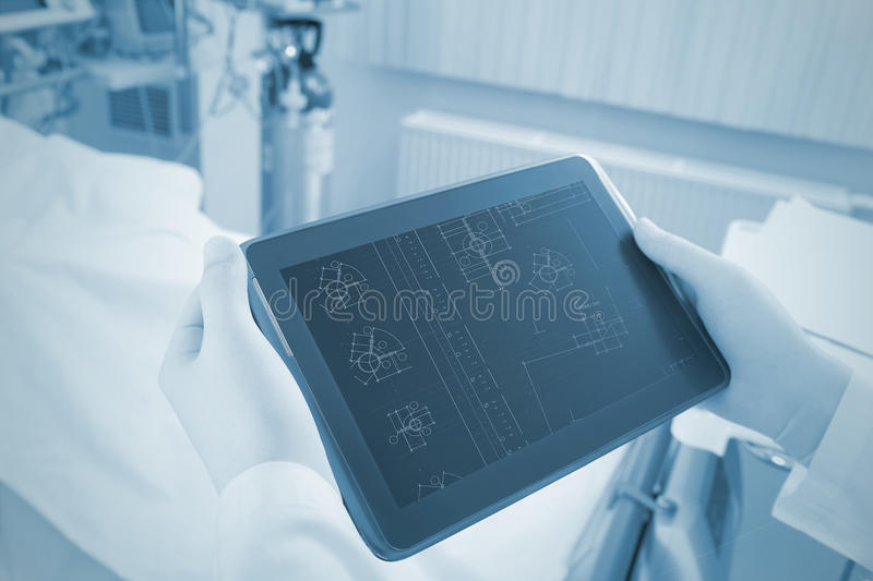 Engineering and technological solutions in medicine. Using the Tablet PC stock images