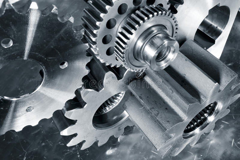 Engineering and technology, gears and cogs. Engineering, gears and cogs connecting industrial parts made of titanium royalty free stock image