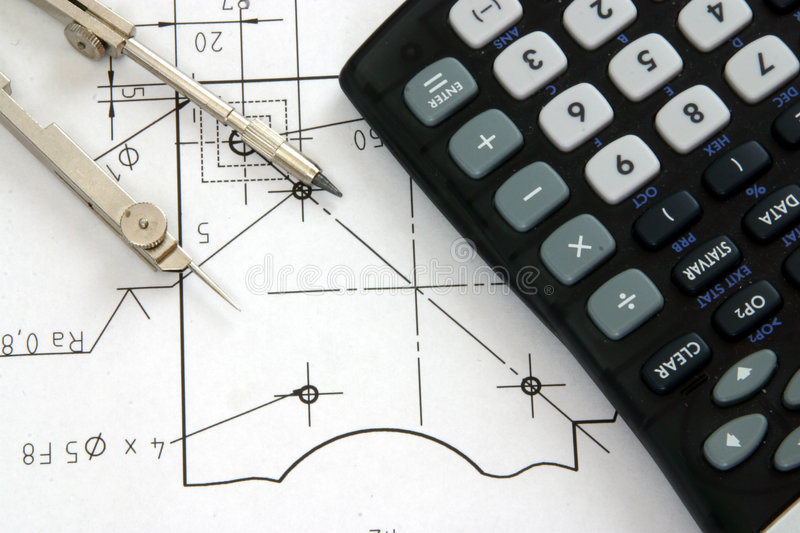 Engineering tools. A close up of a compass and scientific calculator laying on a detailed technical drawing or blueprint, all tools used by an engineer or royalty free stock photos