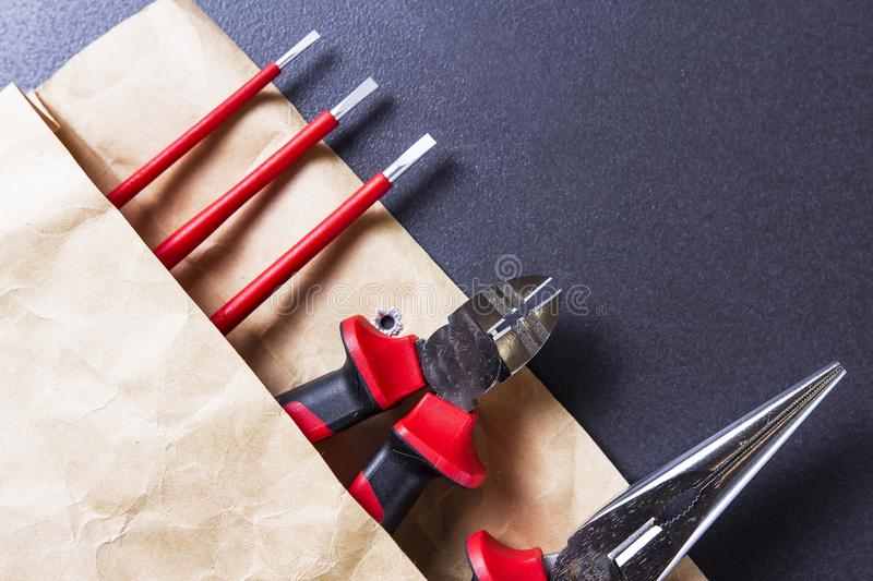 Engineering tools. Tools for electrician work. Screwdriver, pliers and platypus pliers. stock photos