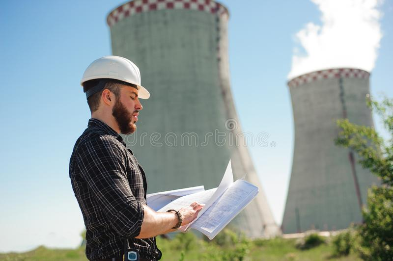 Engineering work at the power plant, check the information on paper. Engineering work at the power plant, check the information on paper royalty free stock photo