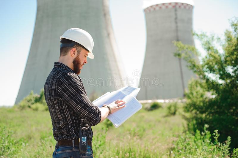 Engineering work at the power plant, check the information on paper. Engineering work at the power plant, check the information on paper royalty free stock photos