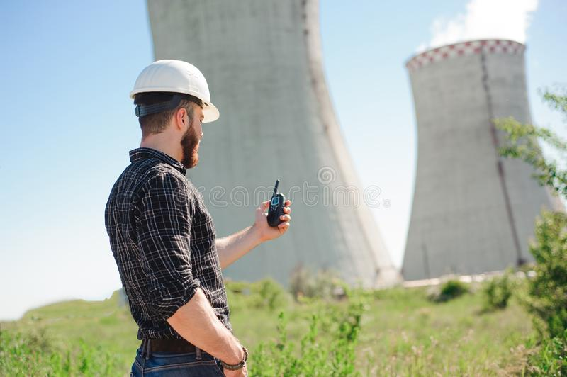 Engineering work at the power plant, check the information on radio set. Engineering work at the power plant, check the information on radio set royalty free stock photo
