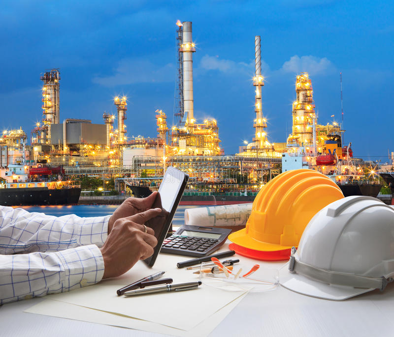 Engineering working on computer tablet against beautiful oil re royalty free stock image