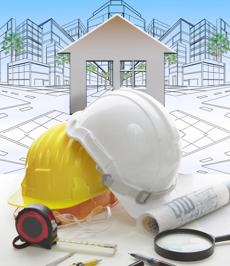 Engineering working table writing tool ,equipment ,and safety helmet against two point perspective of building exterior stock images