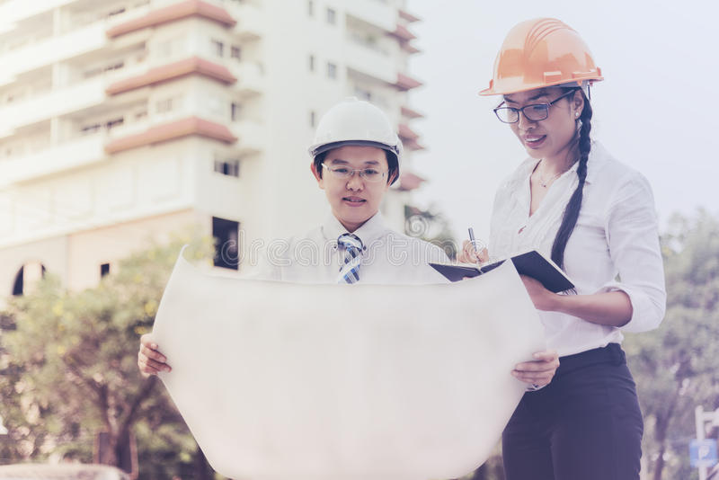 Engineers and architect working in a construction site royalty free stock photo