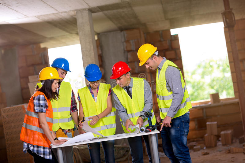 Engineers and architects working together stock photos