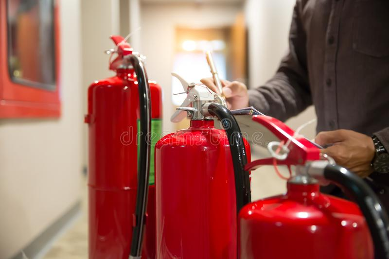Engineers are checking fire extinguishers stock photos