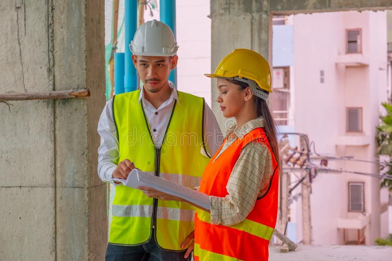 Engineers are discussing at building site stock photography