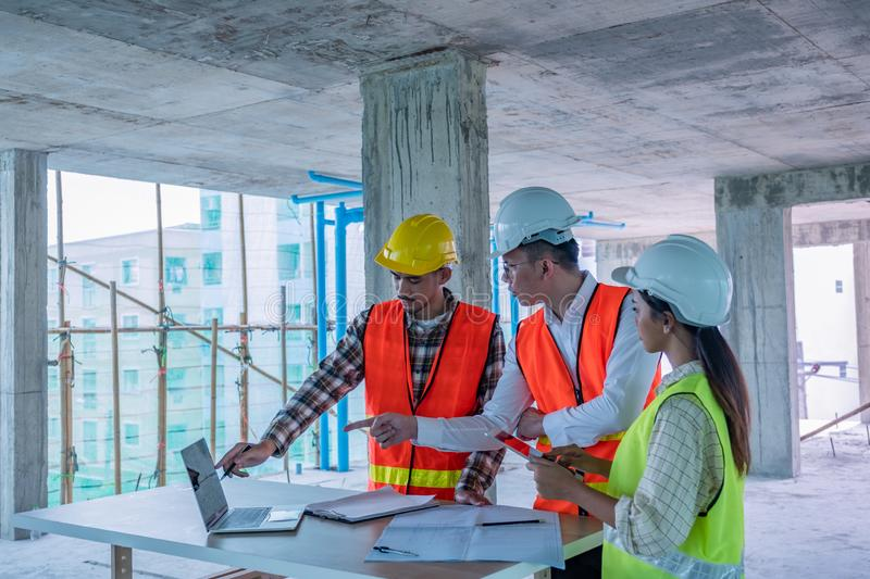 Engineers are discussing at building site royalty free stock image