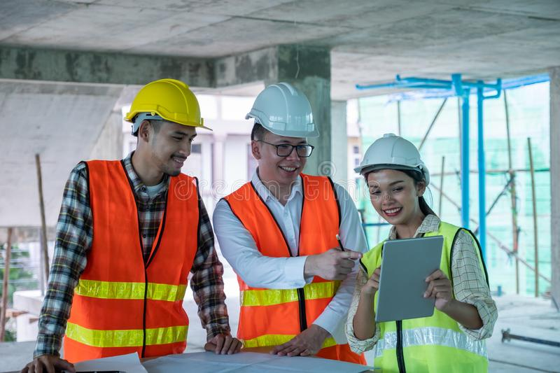 Engineers are discussing at building site royalty free stock photography