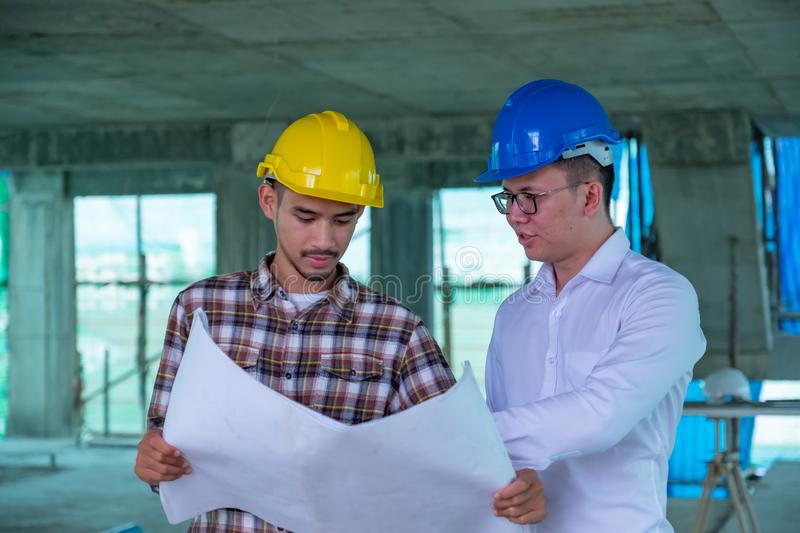 Engineers are discussing at building site stock images