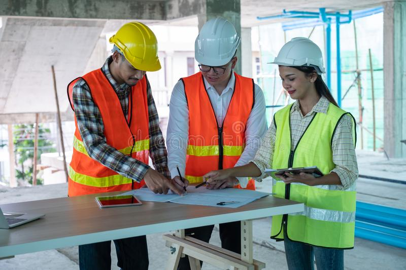 Engineers are discussing at building site royalty free stock photo