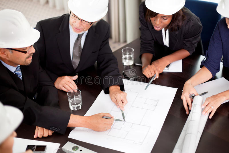 Engineers discussing about a new project stock photos
