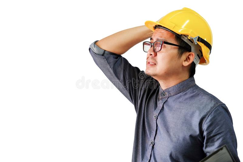 Engineers are either strained or stressed out by working hard. Engineers are either strained or stressed out by working a white background stock photos
