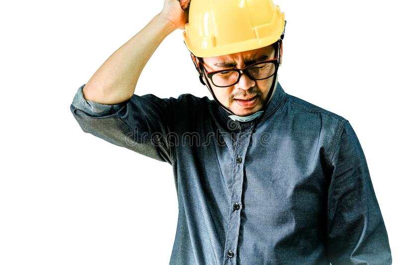 Engineers are either strained or stressed out by working hard. Engineers are either strained or stressed out by working a white background royalty free stock photography
