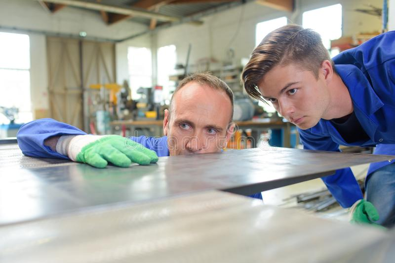 Engineers looking at their work stock photo