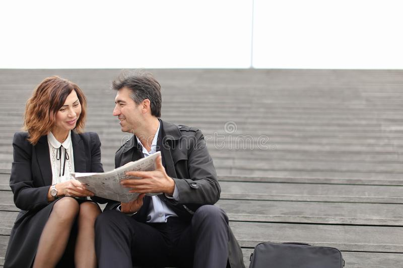 engineers male and female reading article about company in royalty free stock images