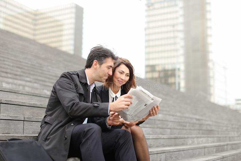 engineers male and female reading article about company in royalty free stock photo