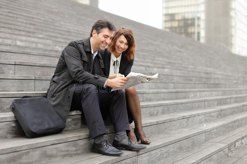 engineers male and female reading article about company in royalty free stock photos