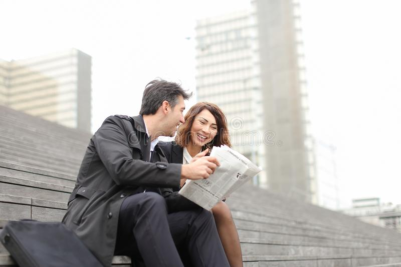 engineers male and female reading article about company in royalty free stock image
