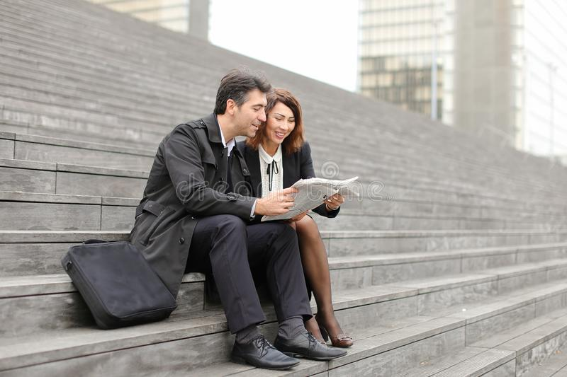 engineers male and female reading article about company in stock photos