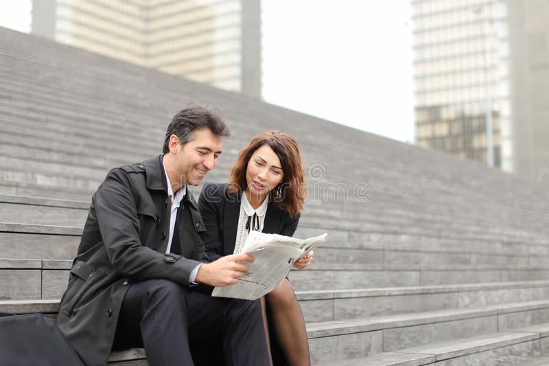 engineers male and female reading article about company in royalty free stock photography