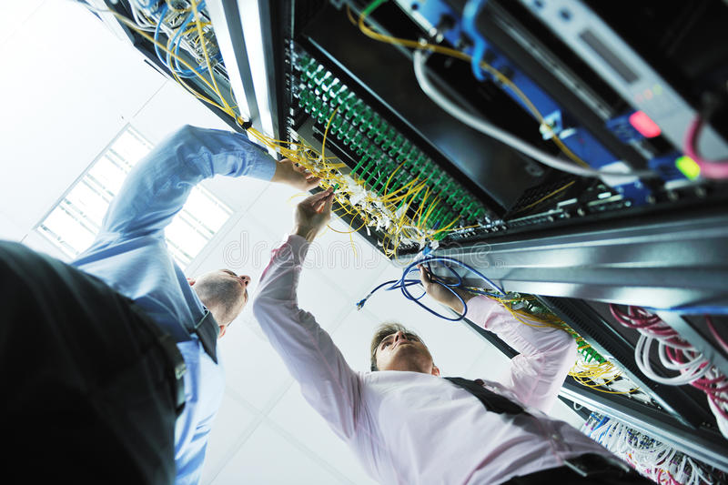 It engineers in network server room royalty free stock photos