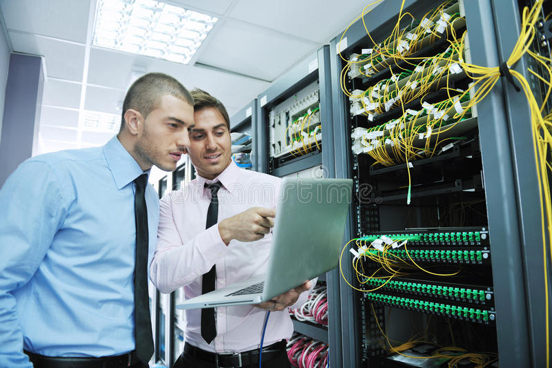 It engineers in network server room stock photos