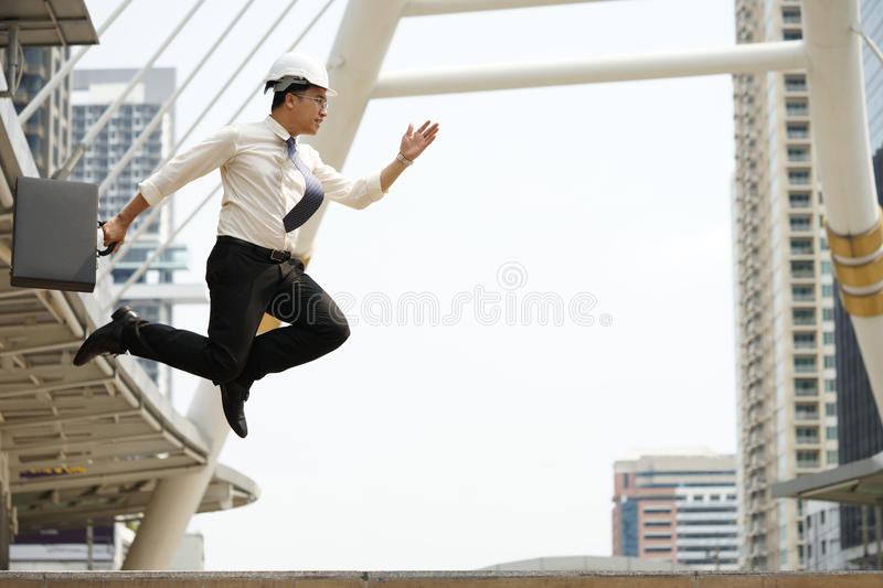 Engineers strive jump high as possible in order achieve goals royalty free stock photography