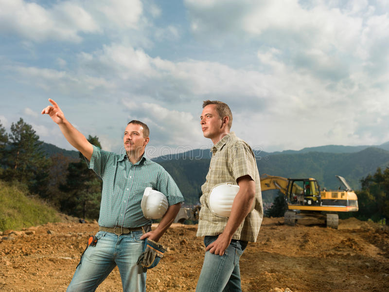 Engineers supervising construction in progress royalty free stock images