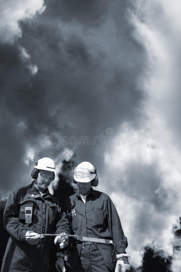 Engineers and toxic clouds stock photos