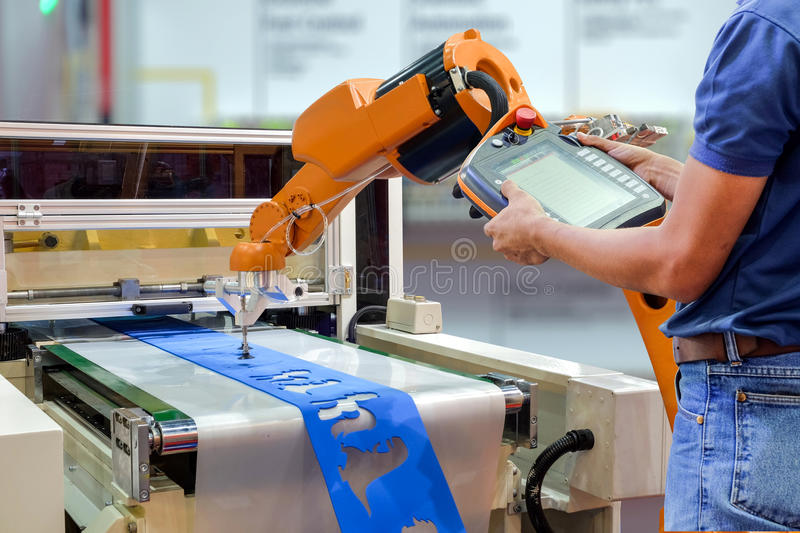 Engineers use a wireless remote control robot stock photos