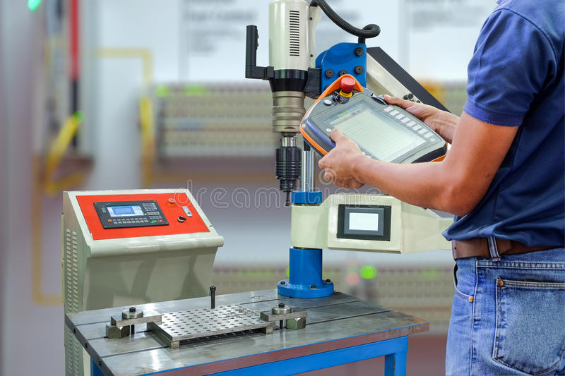 Engineers use wireless remote control a robot to install drill for drilling stock photos